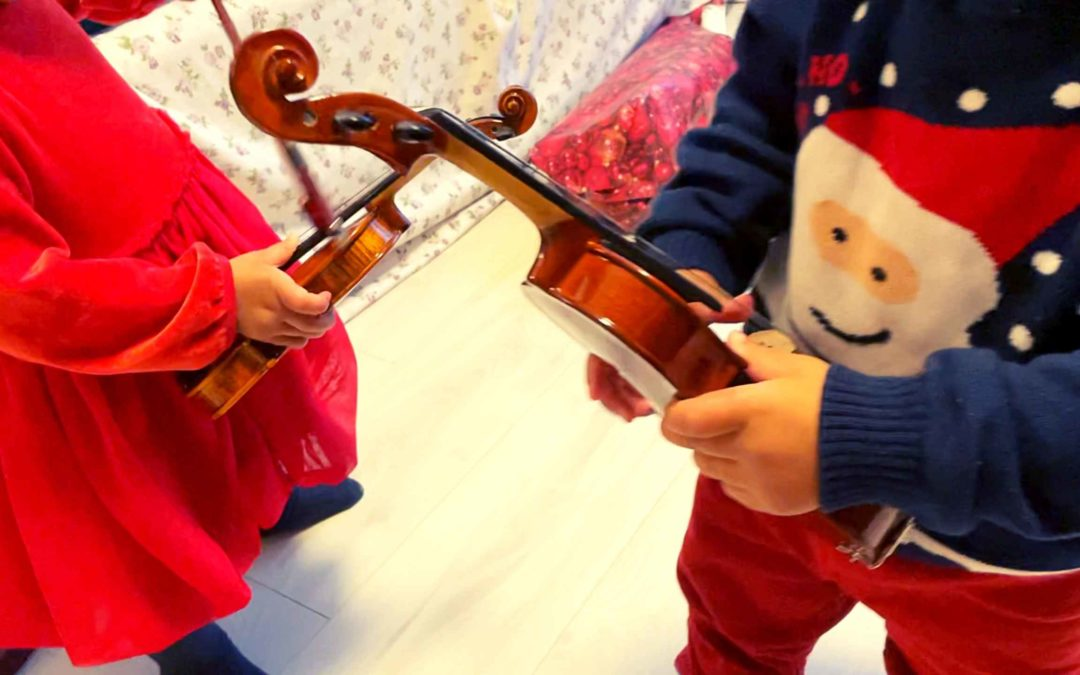 My twin babies got tiny violins for Christmas 😍🎄